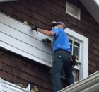 Removing the siding from the Marrons' house.